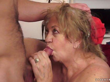 Big superannuated grandma massages her crony toy