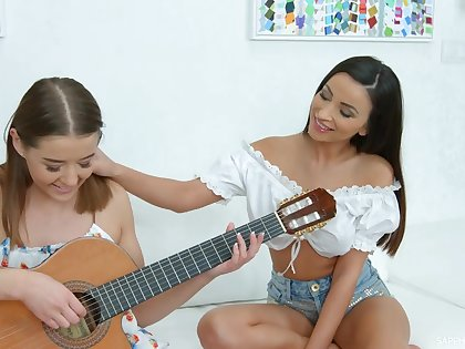 Romanian babe Alyssia Kent is teaching GF hot to play the guitar together with at a loss for words pussy