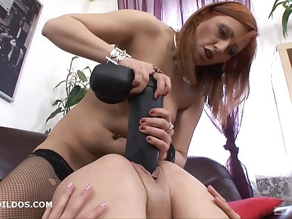 Cloudy lesbian moans while getting spooked with a massive dildo